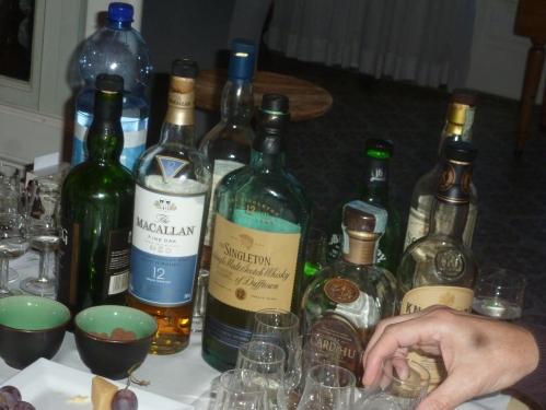 Zes flessen op een rij